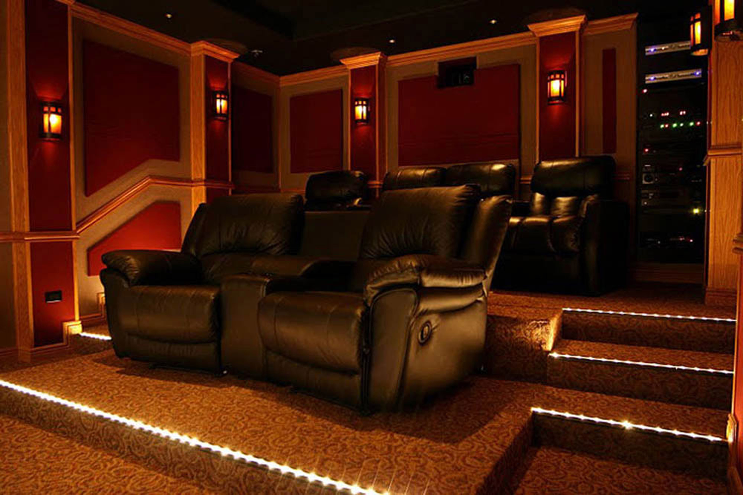 A dedicated home theater needs just the right lighting to set the tone.